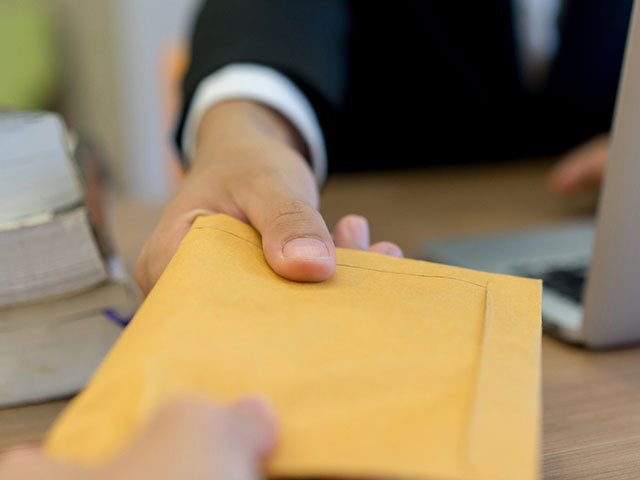 Being served: envelope handed from one person to another