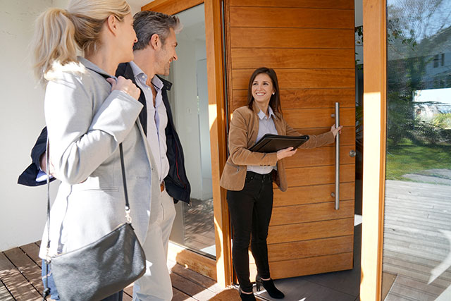 REALTOR showing house to clients